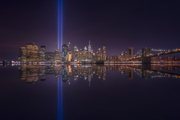 USA, New York, New York City, Manhattan skyline with Tribute in Light at night