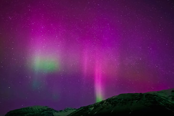 Papiers peints Aurore polaire Aurora borealis in night northern sky. Ionization of air particles in the upper atmosphere.