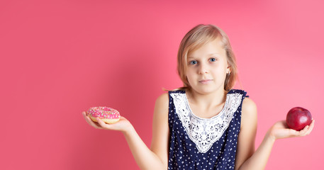 A picture of young girl choosing between red apple and donut. What to choose. doubt