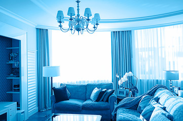 Modern living room interior in classic blue color.
