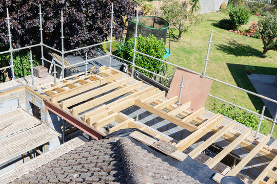 Residential renovation project. Unfinished structure of the roof