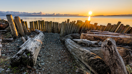 Amazing December sunrise at Goose Spit Regional Park on Vancouver Island in Comox Valley, British Columbia, Canada. Wall mural
