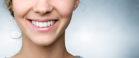 Beautiful smile of young woman with healthy white teeth