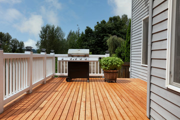 Outdoor home deck with bbq cooker and herbs