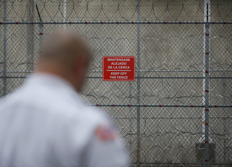 A sign in Spanish and English telling detainees to keep off the fence in the recreation yard during a media tour at Northwest ICE Processing Center in Tacoma