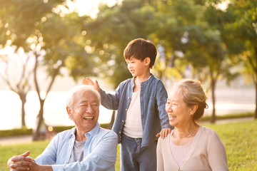 asian grandparents enjoying good time with grandson