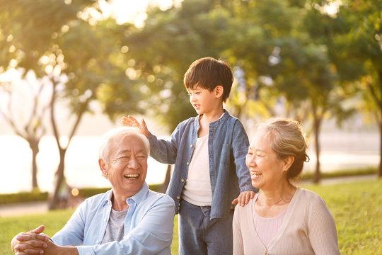 asian grandparents enjoying good time with grandson