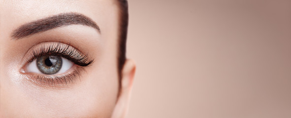 Female Eye with Extreme Long False Eyelashes. Eyelash Extensions. Makeup, Cosmetics, Beauty. Close up, Macro	 Fototapete