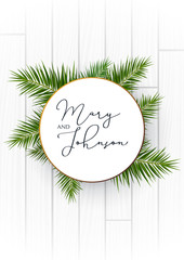 Wall Mural - Wedding Invitation with palms on the white wooden background.