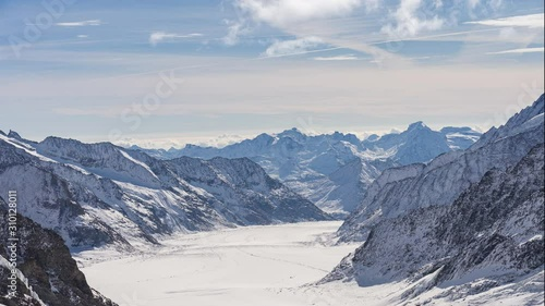 Wall mural Time lapse video of Jungfrau with blue nice sky in Switzerland