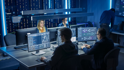 Team of IT Programers Working on Desktop Computers in Data Center System Control Room. Team of Young Professionals Working In Software and Hardware Development, Doing Coding