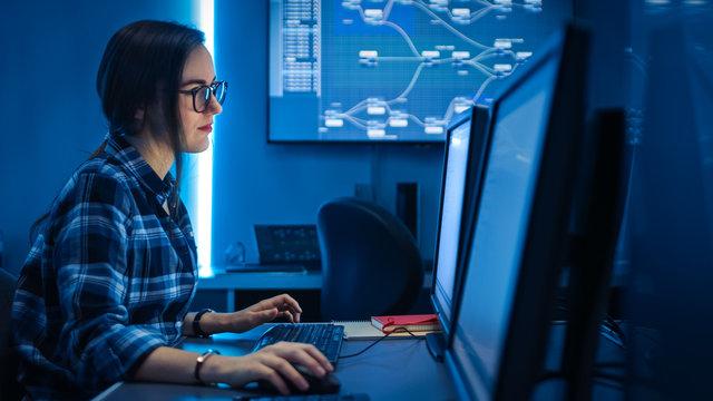 Smart Female IT Engineer / Programer Working on Desktop Comuter. Software Development / Coding/ Web Design / Database Architecture. Young Girl STEM Graduate Working