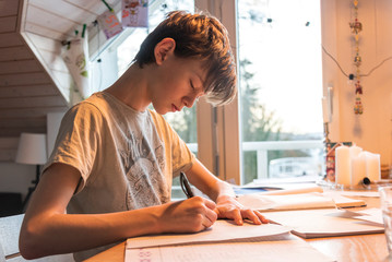 young student studying and doing homework