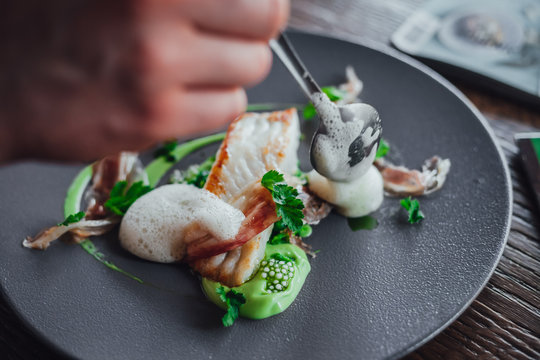 Fish food on plate  in michelin star restaurant