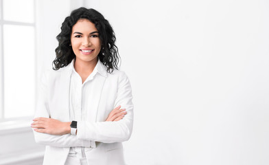 Successful hispanic manager standing at modern office Wall mural