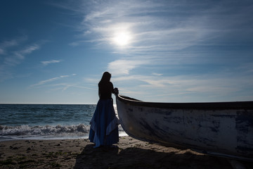 Silhouette of woman by the sea