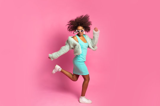 Full length body size studio photo shooting portrait of beautiful pretty nice cute charming careless lady jumping isolated on bright vivid color pastel background