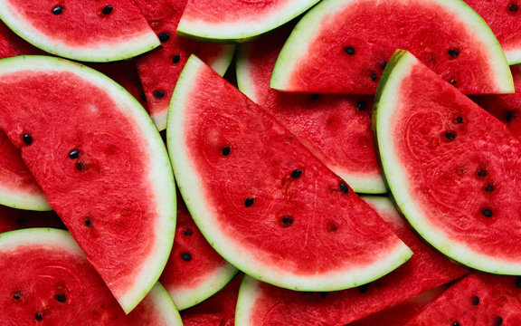 A large number of cut slices of watermelon