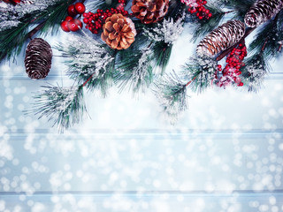 Printed kitchen splashbacks Light blue winter background with fir branches cones and snow