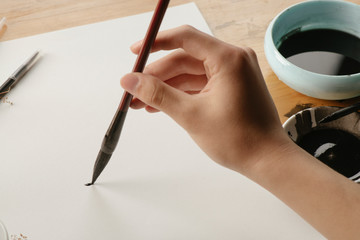 Write with a Chinese brush