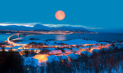 Urban landscape of Tromso in Northern Norway with full moon - Arctic city of Tromso with bridge -Tromso, Norway