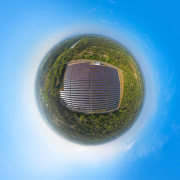Little planet 360 degree sphere. Panorama of aerial view of solar panels or solar cells on the roof in farm. Power plant with green field, renewable energy source in Thailand.