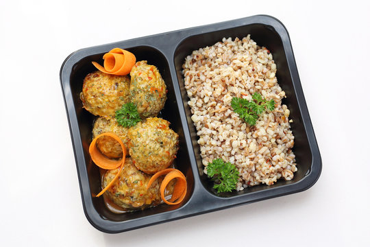 Dietary chicken meatball with vegetables. Easy-to-digest diet in a box. Ready meal in a box on a white background.