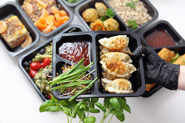 Meal prep containers, the chef prepares a meal in a boxed diet delivered to order.