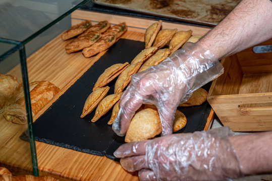 Putting pastry shell on the display of a coffee shop in Madrid, Spain