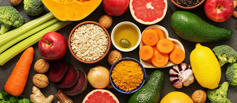 Liver detox diet food concept, fruits, vegetables, nuts, olive oil, garlic. Cleansing the body, healthy eating. Top view, flat lay,banner.