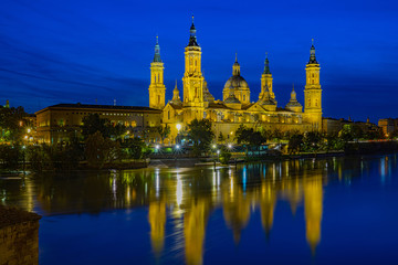 Cathedral, Basilca El Pilar, in Zaragoza, Aragon, Spain, Europe at blue hour with river Ebro in the front, done with long time exposure