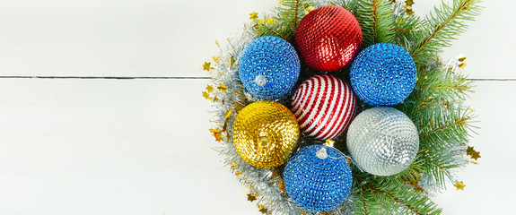 Christmas decorations on a white wooden background. Free space for text. Wide photo .
