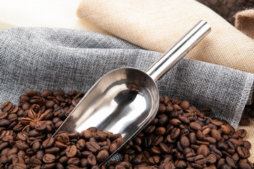 Wall Mural - roasted coffee beans with scoop on a bag