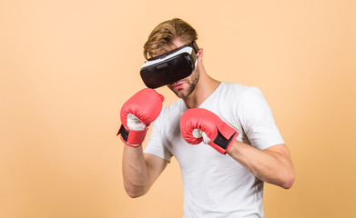 no pain no gain. modern gadget. Training boxing game. boxing in virtual reality. Digital sport success. vr boxing. future innovation. man in VR glasses. Futuristic gaming. man use new technology