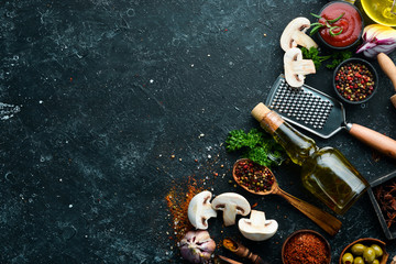 Fototapete - Food background. Spices, herbs and kitchen tools. Top view. free space for your text. Rustic style.