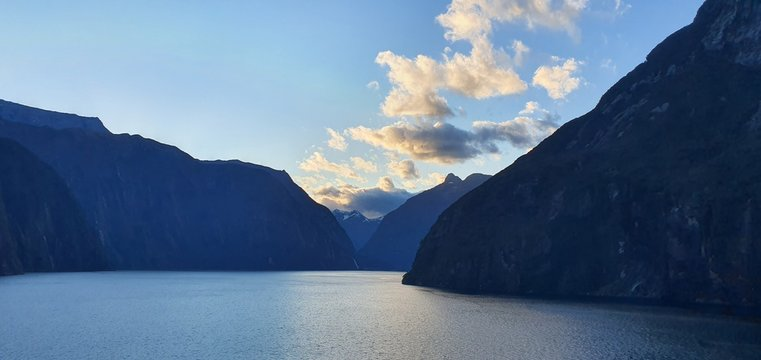 Milford Sound Fjord, Milford Sound / New Zealand - December 18, 2019: The Dramatic Mountains and Waterfalls of the Milford Sound Fjord, New Zealand