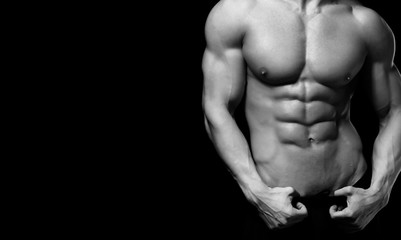 Perfect man body on black background