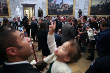 A little girl points to the painted ceiling as U.S. Vice President Pence greets visitors in the Rotunda after meeting with Senate Republicans at the U.S. Capitol in Washington