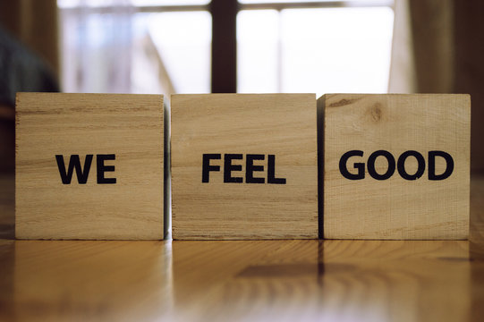 Wooden cubes with the words WE FEEL GOOD