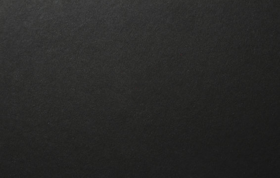 old black paper texture background, copy space.