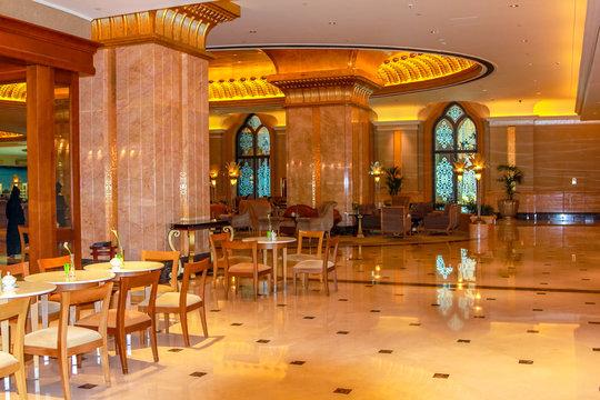 Abu Dhabi, United Arab Emirates - April 21, 2013: monumental entrance of Emirates Palace, luxurious hotel and landmark in Abu Dhabi. Decorations with gold, marble and Swarovski. Luxury travel concept.