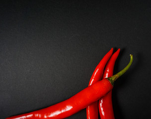 Canvas Prints Hot chili peppers Top view of red hot chili pepper over black background.