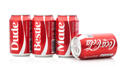 Row of share with Coca-Cola cans on a white background