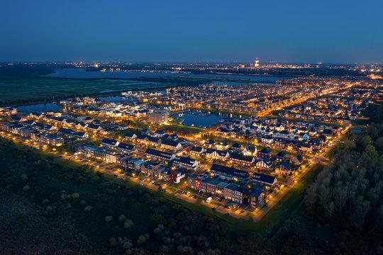 Modern suburban district Noorderplassen in Almere, The Netherlands. Situated on Flevoland polder between nature reserves Lepelaarsplassen and Pampushout. Aerial shot.