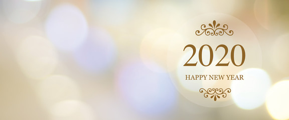 Happy New Year 2020 on blur abstract bokeh background with copy space for text, new year greeting card, banner