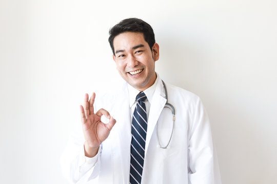 Asian man in Doctor uniform on white background in hospital