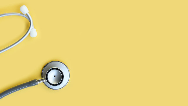 close up of stethoscope on yellow background