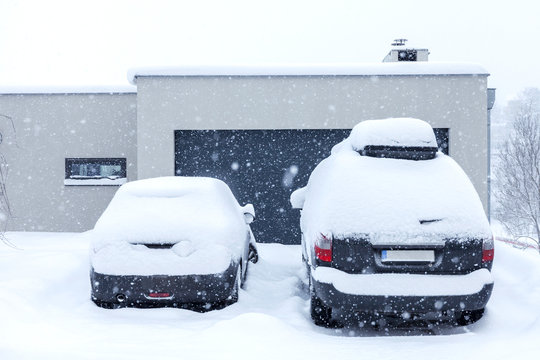 Cars on house driveway