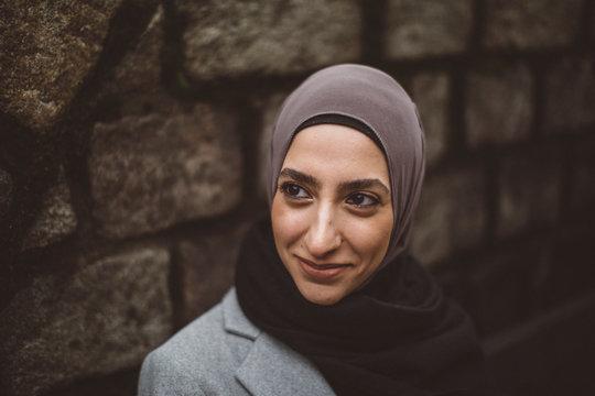 Smiling woman wearing hijab