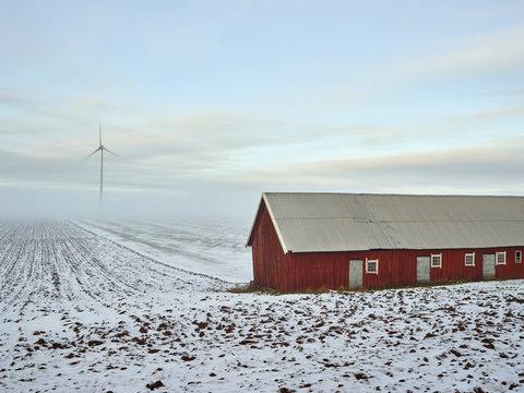 Barn on plowed field
